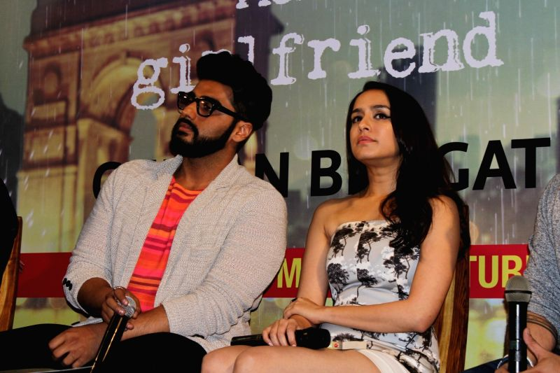 "Actors Shraddha Kapoor and Arjun Kapoor at the launch of Chetan Bhagat's book ""Half Girlfriend""  in Mumbai on May 8, 2017. - Shraddha Kapoor and Arjun Kapoor"