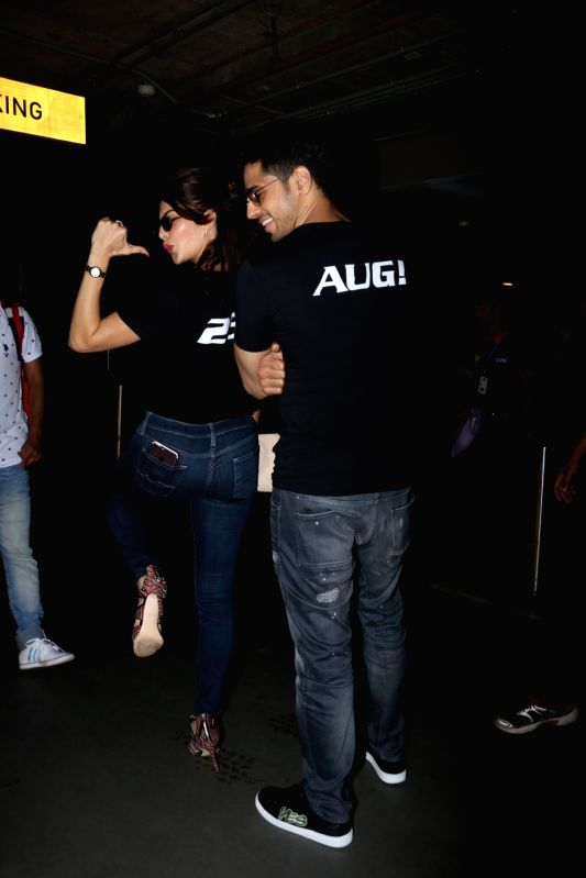 Actors Sidharth Malhotra and Jacqueline Fernandez spotted at Chhatrapati Shivaji Maharaj International airport in Mumbai on Aug 24, 2017. - Sidharth Malhotra and Jacqueline Fernandez