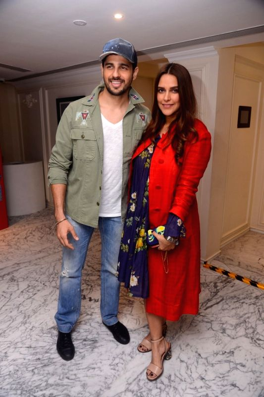"""Actors Sidharth Malhotra and Neha Dhupia at the special screening of Netflix show titled """"Lust Stories"""" in Mumbai on June 13, 2018. - Sidharth Malhotra and Neha Dhupia"""