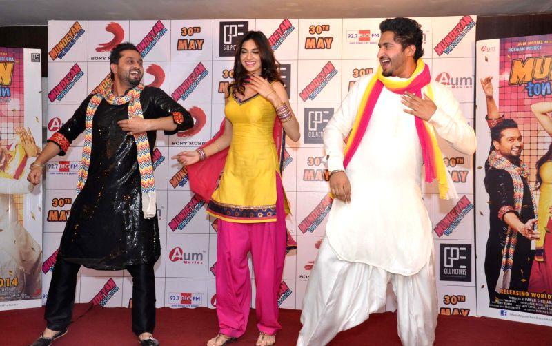 Actors Simran Kaur Mundi, Jassi Gill, and singer Roshan Prince during a press conference to promote their upcoming film 'Mundeyan Ton Bachke Rahin' in Jalandhar on May 6, 2014. - Simran Kaur Mundi and Jassi Gill