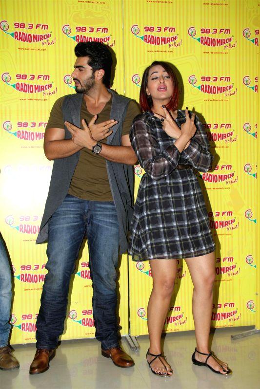 Actors  Sonakshi Sinha and Arjun Kapoor promote their film Tevar at 98.3 FM Radio Mirchi Studios in Mumbai on Dec 10, 2014. - Sonakshi Sinha and Arjun Kapoor