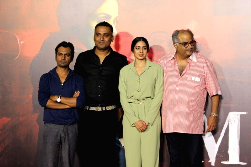 "Actors Sridevi, Nawazuddin Siddiqui and producer Boney Kapoor during the trailer launch of their upcoming film ""Mom"" in Mumbai, on June 3, 2017. - Sridevi, Nawazuddin Siddiqui and Kapoor"