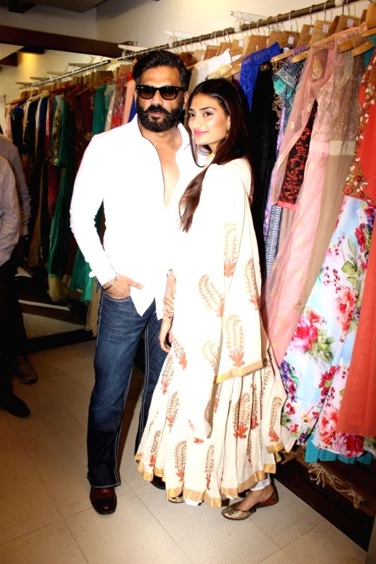 Actors Suniel Shetty and Athiya Shetty during a exhibition in Mumbai. - Suniel Shetty and Athiya Shetty