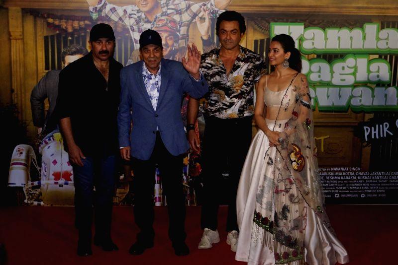 "Actors Sunny Deol, Dharmendra, Bobby Deol and Kriti Kharbanda at the trailer launch of their upcoming film ""Yamla Pagla Deewana Phir Se"" in Mumbai on Aug 10, 2018. - Sunny Deol, Dharmendra, Bobby Deol and Kriti Kharbanda"