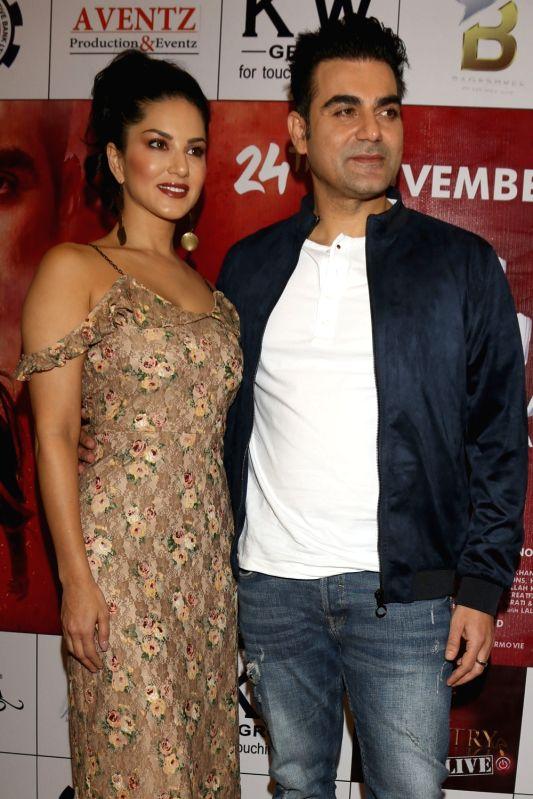 """Actors Sunny Leone and Arbaaz Khan during a press conference to promote their upcoming film """"Tera Intezaar"""" in New Delhi on Nov 21, 2017. - Sunny Leone and Arbaaz Khan"""