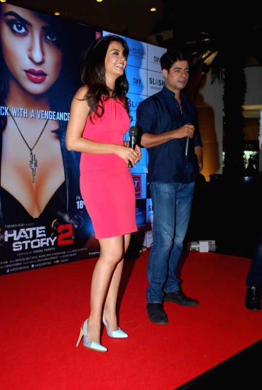 Actors Surveen Chawla and Sushant Singh during the promotion of film Hate Story 2 in Mumbai on July 12, 2014. - Surveen Chawla and Sushant Singh