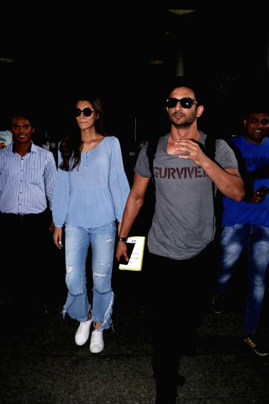 Actors Sushant Singh Rajput and Kriti Sanon were spotted at the Mumbai airport on June 7, 2017. - Sushant Singh Rajput and Kriti Sanon