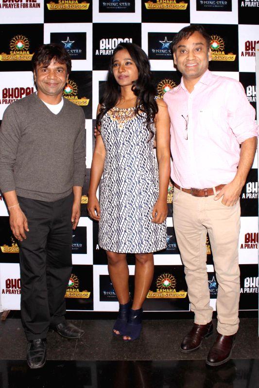 Actors Tannishtha Chatterjee, Rajpal Yadav and filmmaker Ravi Kumar during the promotion of film ``Bhopal a Prayer for Rain in New Delhi on Dec 2, 2014. - Tannishtha Chatterjee, Rajpal Yadav and Ravi Kumar