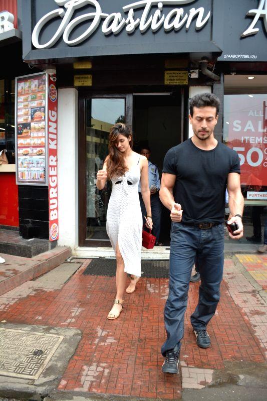 Actors Tiger Shroff and Disha Patani  seen at Mumbai's Bandra on Aug 9, 2018. - Tiger Shroff and Disha Patani