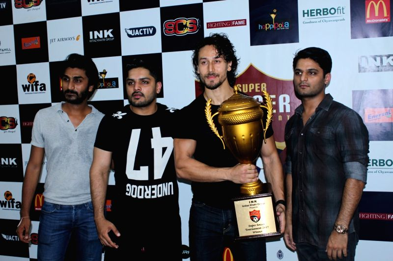 Actors Tiger Shroff and Irfan Khatri during the launch of second edition of Super Soccer Tournament (SST) in Mumbai on May 28, 2017. - Tiger Shroff and Irfan Khatri