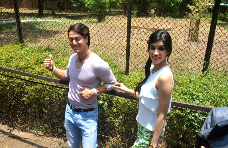 Actors Tiger Shroff and Kirti Sanon at Maharajbagh zoo where Shroff has legally adopted a four-year-old tiger, Jaan in Nagpur on May 17, 2014. - Kirti Sanon