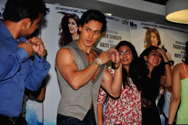 Actors Tiger Shroff and Kriti Sanon celebrate World Dance day during the promotion of upcoming film Heropanti in Mumbai on April 28, 2014. - Tiger Shroff and Kriti Sanon