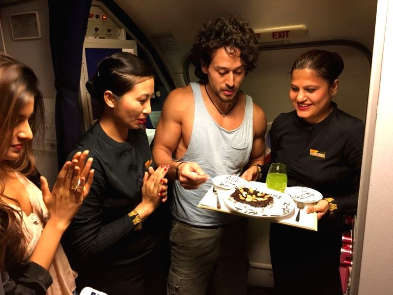 Tiger Shroff, Nidhi Agarwal while flying - Tiger Shroff and Nidhi Agarwal