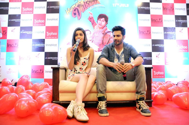 Actors Varun Dhawan and Alia Bhat during a press conference to promote their upcoming film `Humpty Sharma Ki Dulhania` in Bangalore on July 4, 2014. - Varun Dhawan and Alia Bhat