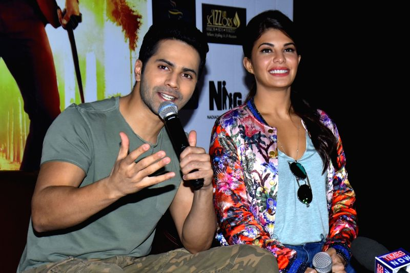 """Actors Varun Dhawan and Jacqueline Fernandez during a press conference to promote their upcoming film """"Dishoom"""" in Jaipur on July 19, 2016. - Varun Dhawan and Jacqueline Fernandez"""