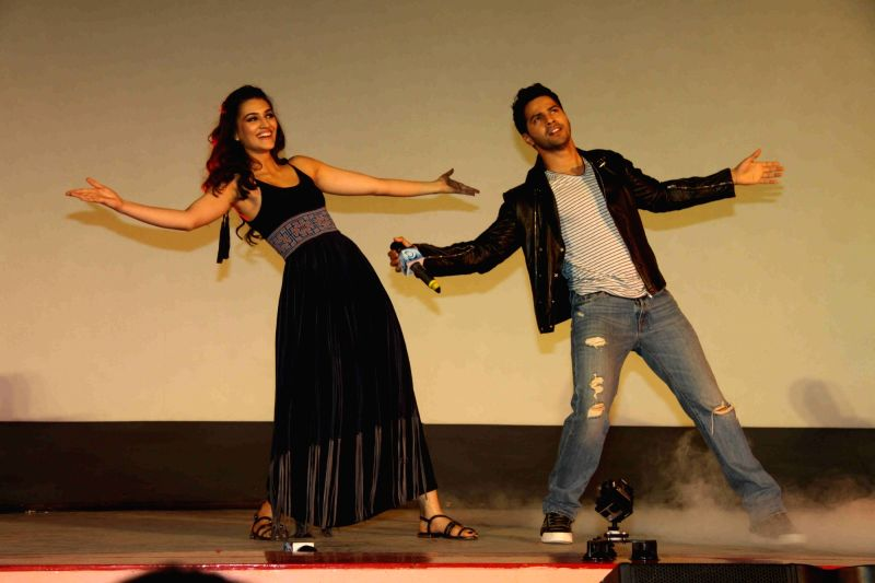 Actors Varun Dhawan and Kriti Sanon during the song launch of film Dilwale in Mumbai on Nov 18, 2015. - Varun Dhawan and Kriti Sanon