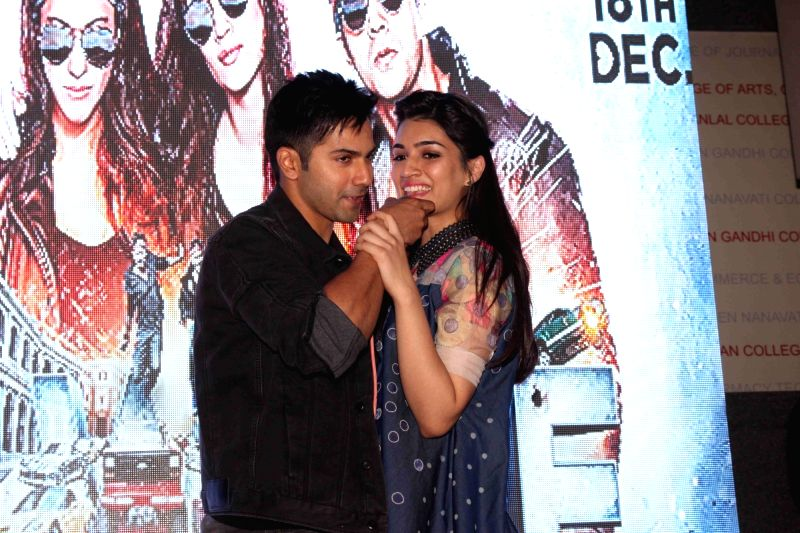 Actors Varun Dhawan and Kriti Sanon during the promotion of film Dilwale in Mumbai on Dec 7, 2015. - Varun Dhawan and Kriti Sanon