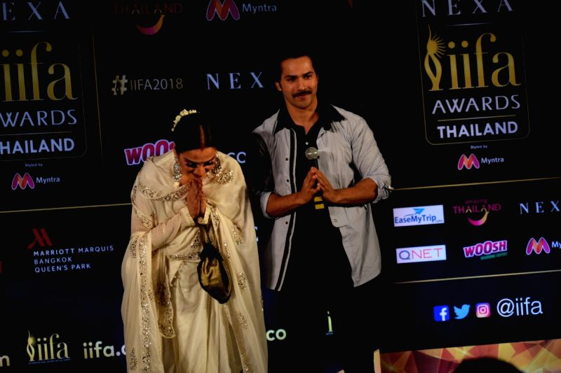 Actors Varun Dhawan and Rekha during a press conference of the 19thEdition of IIFA in Mumbai on June 12, 2018. - Varun Dhawan and Rekha