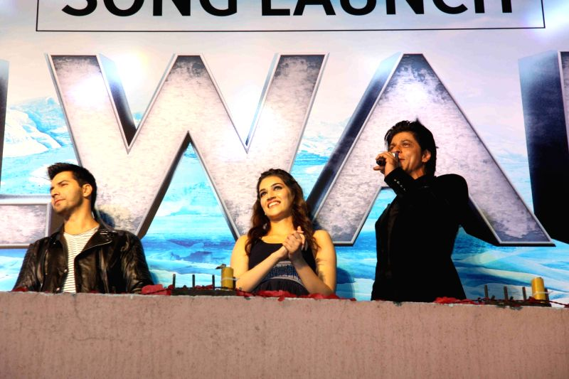 Actors Varun Dhawan, Kriti Sanon and Shah Rukh Khan during the song launch of film Dilwale in Mumbai on Nov 18, 2015. - Varun Dhawan, Kriti Sanon and Shah Rukh Khan