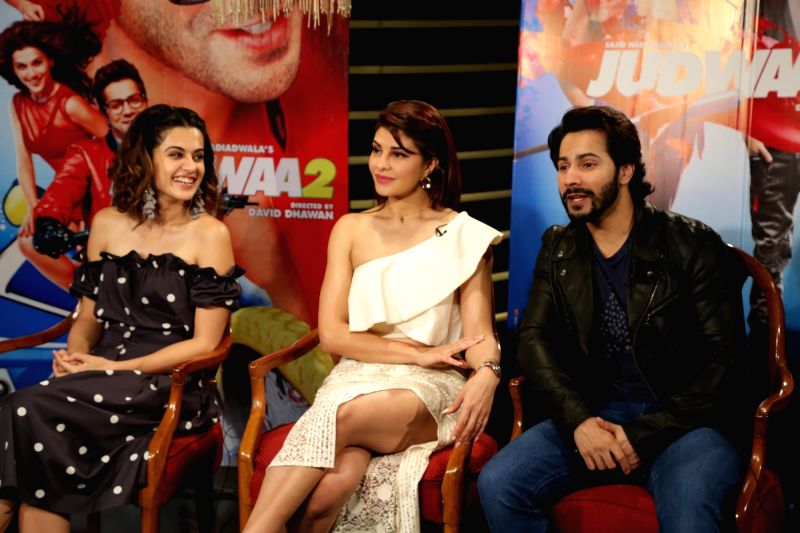 """Actors Varun Dhawan, Tapsee Pannu and Jacqueline Fernandez at a press meet for film """"Judwaa 2"""", in New Delhi on Sept. 26, 2017."""