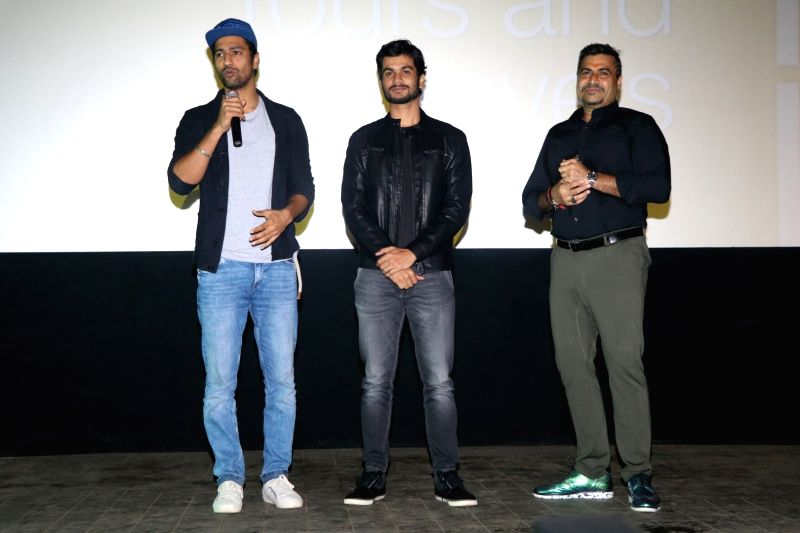 Actors Vicky Kaushal and Sunny Kaushal with filmmaker Shailendra during the trailer launch of film Sunshine Music Tours and Travels in Mumbai on July 25, 2016. - Vicky Kaushal and Sunny Kaushal