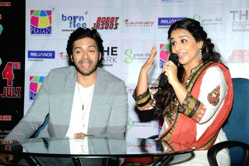 Actors Vidya Balan and Ali Fazal during a press meet of their upcoming film Bobby Jasoos at Prasads IMAX in Hyderabad on June 20, 2014. - Vidya Balan and Ali Fazal