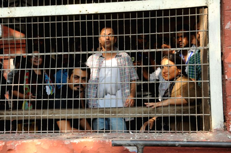 Actors Vidya Balan and Nawazuddin Siddiqui with director Sujoy Ghosh during shooting for their upcoming film `Te3n` at Writers Building in Kolkata on Nov 25, 2015. - Nawazuddin Siddiqui and Sujoy Ghosh