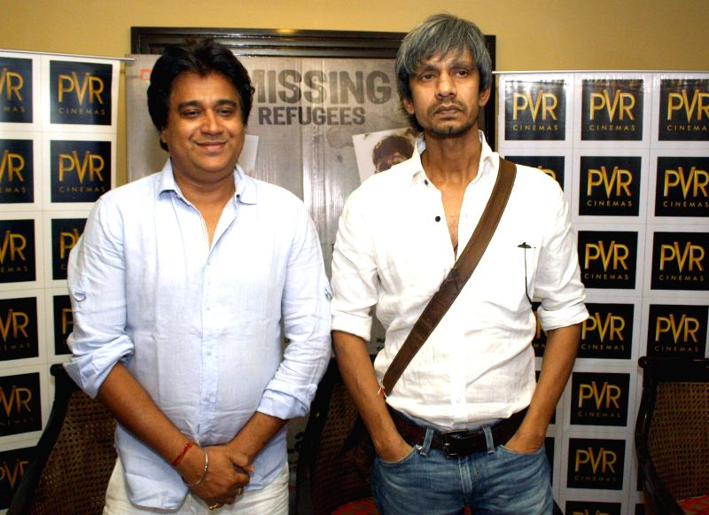 Actors Vijay Raaz and Manu Rishi  during a press conference to promote their upcoming film 'Kya Dilli Kya Lahore' in New Delhi on April 29, 2014. - Vijay Raaz and Manu Rishi