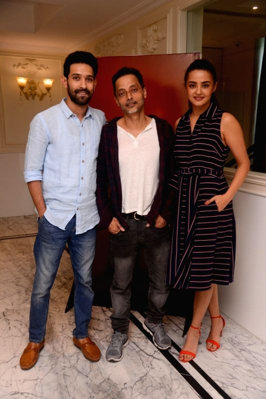 "Actors Vikrant Massey, Surveen Chawla and Filmmaker Sujoy Ghosh at the launch of television show ""Teen Paheliyan"" in Mumbai on April 13, 2018 . - Filmmaker Sujoy Ghosh, Vikrant Massey and Surveen Chawla"