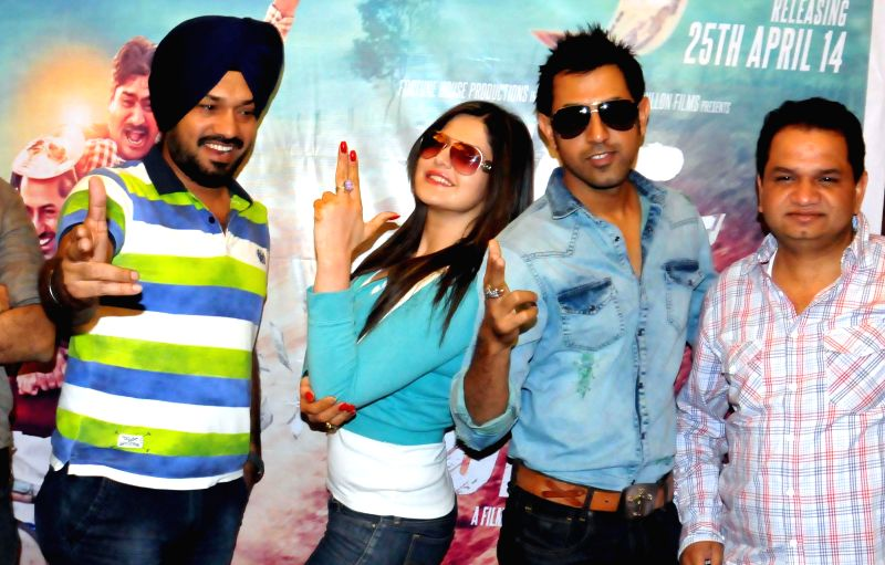 Actors Zarine Khan, Gippy Grewal and Gurpreet Guggi during a press conference to promote their upcoming film 'Jatt James Bond' in Amritsar on April 22, 2014. - Zarine Khan, Gippy Grewal and Gurpreet Guggi
