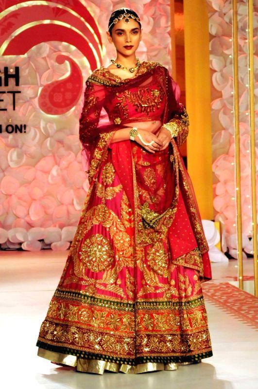 Actress Aditi Rao Hydari walks the ramp during a fashion show in Noida on May 14, 2016. - Aditi Rao Hydari