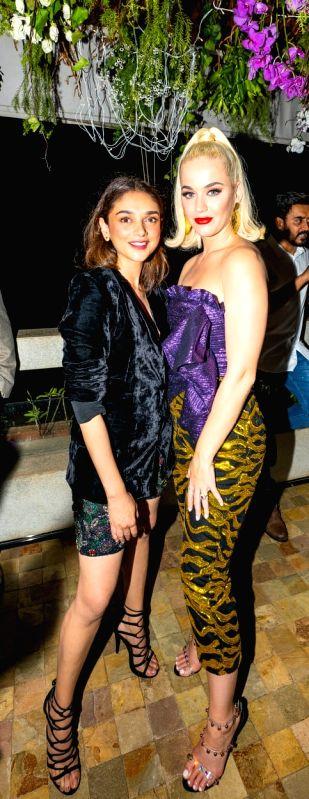 Actress Aditi Rao Hydari with pop singer Katy Perry at a party hosted by filmmaker Karan Johar at his residence.