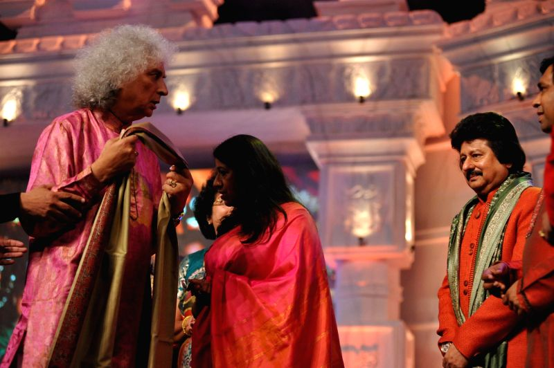 Actress Aishwarya Rai Bachchan and Ghazal singer Pankaj Udhas with Santoor player Pandit Shivkumar Sharma during a musical concert of Pure Love Bhagavan Sri Sathya Sai Baba in Mumbai on April 27, ... - Aishwarya Rai Bachchan and Pandit Shivkumar Sharma
