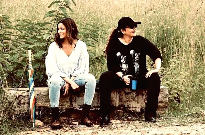 """Actress Alia Bhatt has shared some """"priceless moments"""" with her """"big sister"""" Pooja sister from the sets of """"Sadak 2"""". Alia on Friday took to Instagram and Twitter, where she shared a photograph of herself along with Pooja sitting on a log. Alia is se"""