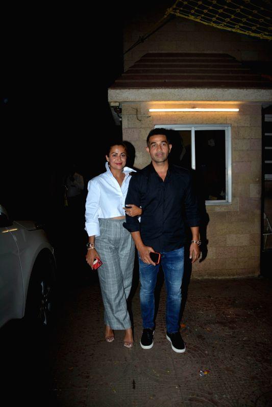 Actress Amrita Arora along with her husband Shakeel Ladak during her mother birthday celebration in Mumbai on Aug 8, 2018. - Amrita Arora