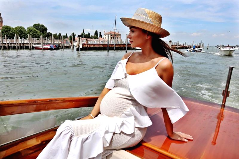 Actress Amy Jackson has shared a photograph flaunting her baby bump, and fans are overjoyed. Dressed in white, the actress is seen enjoying a boat ride here. She posted the photograph on Instagram.