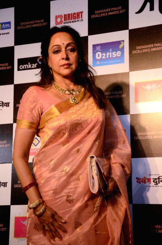 Actress and BJP MP Hema Malini at the red carpet of Dadasaheb Phalke award function in Mumbai on April 21, 2017. Hema Malini was given Dada Saheb Phalke award for her immense contribution in ... - Hema Malini
