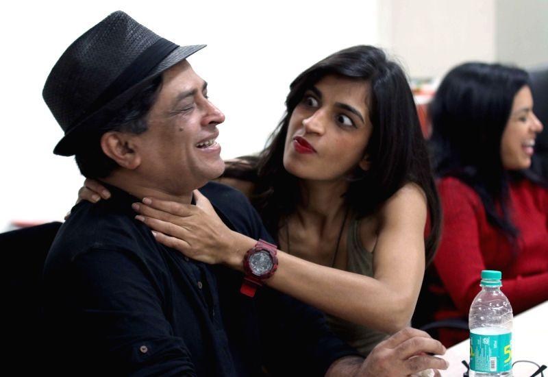 Actress Anushka Manchanda with filmmaker Pan Nalin during their visit to IANS office in New Delhi on Dec 2, 2015. - Anushka Manchanda