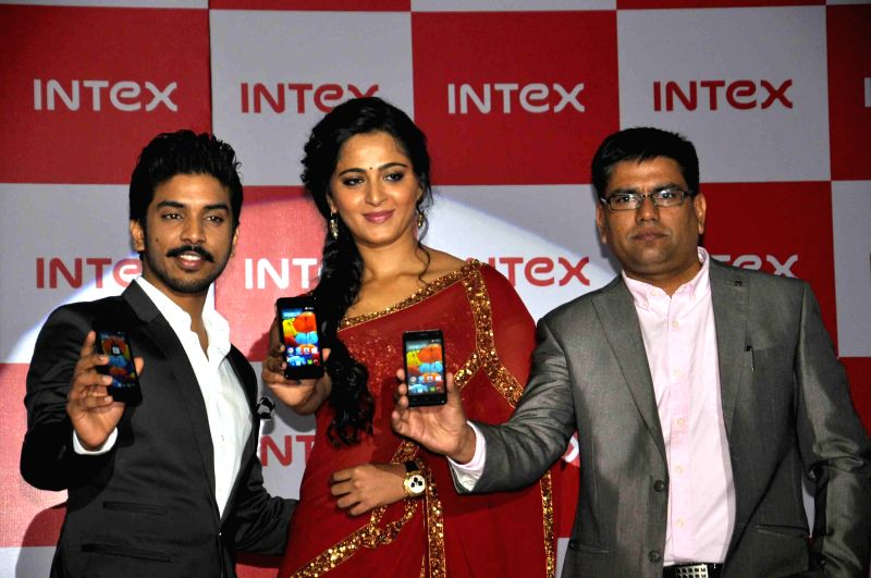Actress Anushka Shetty and Intex director Keshav Bansal launches a new Intex smartphone Aqua in Hyderabad on Aug. 16, 2014. - Anushka Shetty