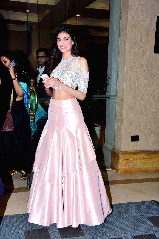 Actress Athiya Shetty at the fashion designer Manish Malhotra's Haute Couture 2018 in Mumbai. - Athiya Shetty and Manish Malhotra