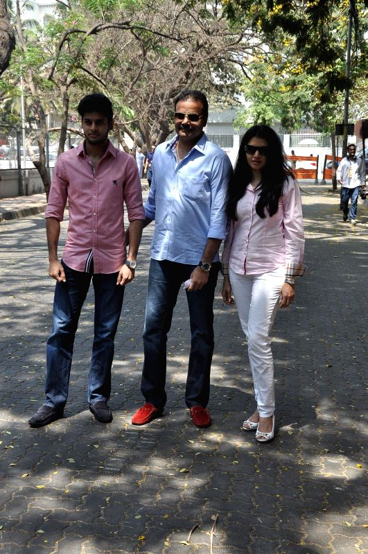Actress Bhagyashree with her family after casting her vote at a polling booth during the sixth phase of 2014 Lok Sabha Polls in Mumbai on April 24, 2014. - Bhagyashree