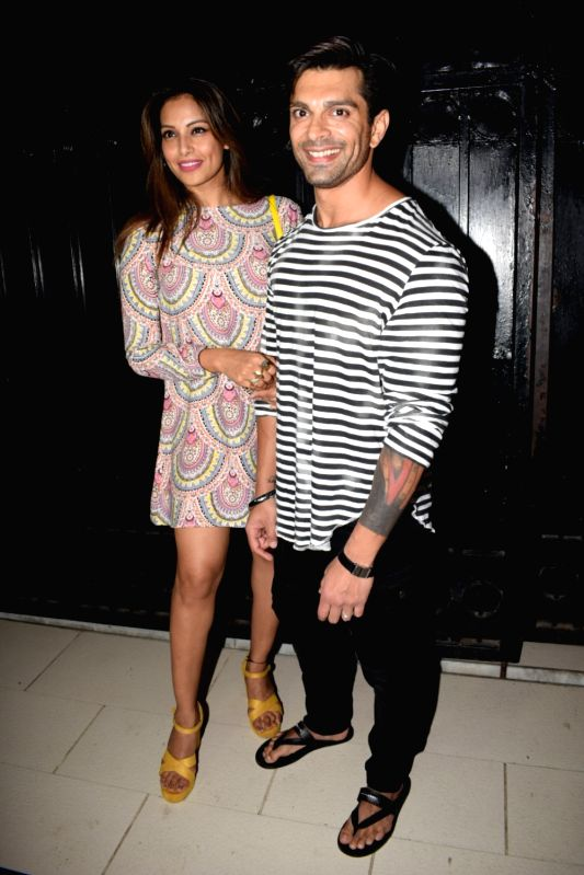 "Actress Bipasha Basu alogn with her husband Karan Singh Grover at the producer Ekta Kapoor's party post web series ""The Test case"" screening in Mumbai on Jan 29, 2018. - Bipasha Basu, Karan Singh Grover and Ekta Kapoor"