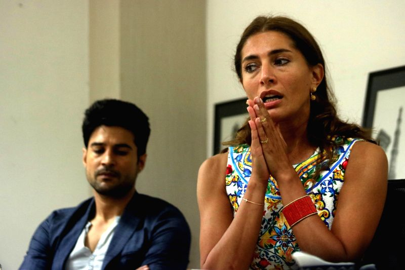 Actress Caterina Murino during an interview at IANS office in New Delhi on July 22, 2016. Also seen actor Rajeev Khandelwal. - Caterina Murino