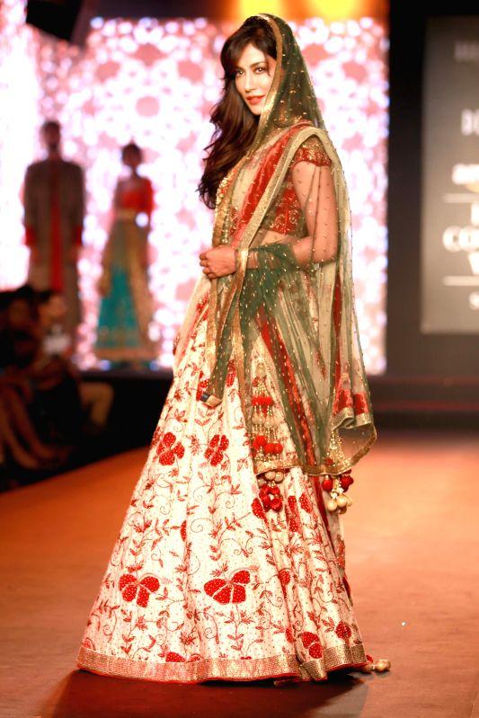 Actress Chitrangada Singh walks on the ramp displaying an outfit by designer Debarun Mukherjee during the Amazon India Couture Week 2015, in New Delhi on Aug 01, 2015. - Chitrangada Singh