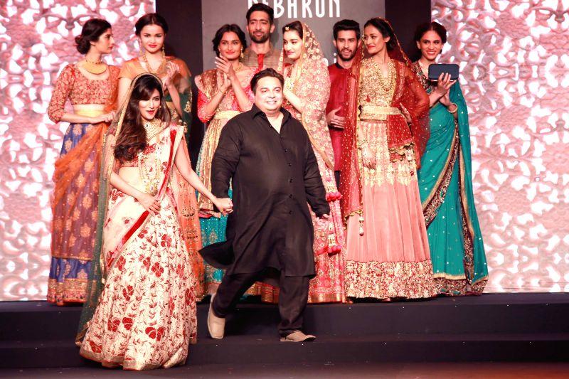 Actress Chitrangada Singh walks on the ramp with designer Debarun Mukherjee during the Amazon India Couture Week 2015, in New Delhi on Aug 01, 2015. - Chitrangada Singh