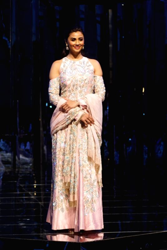 Actress Daisy Shah walks the ramp for fashion designer Manish Malhotra's haute couture show, in Mumbai on Aug 1, 2018. - Daisy Shah and Manish Malhotra