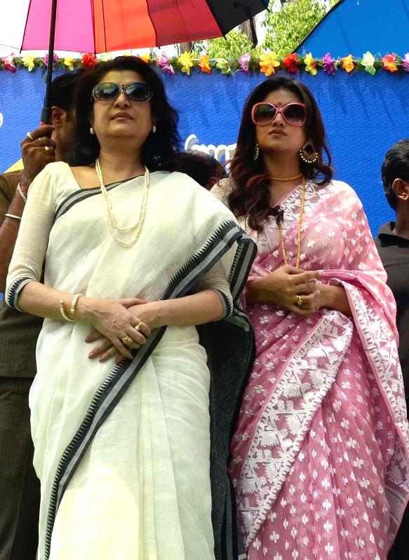 Actress Debosree Roy (L) and Nusrat Jahan (R) during a programme organised on 'Poila Baisakh' in Kolkata on April 15, 2014.