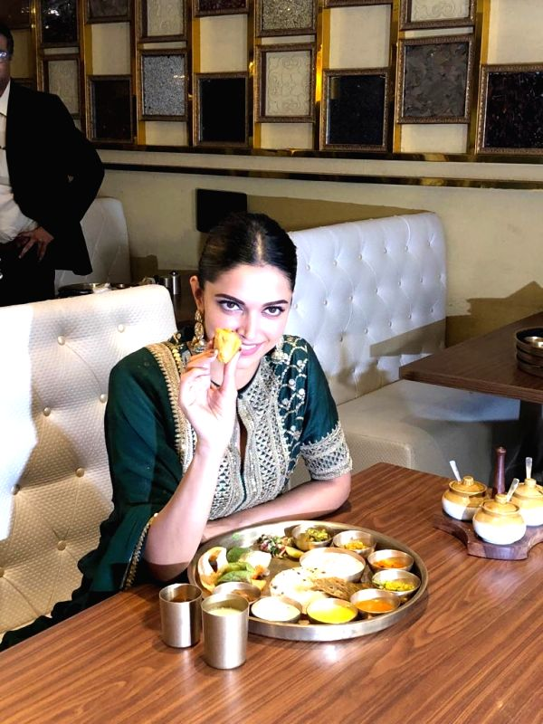 Actress Deepika Padukone feasts over a Rajasthani thali in an attemt to celebrate the success of her recently released film in Mumbai on Jan 27, 2018.  Sanjay Leela Bhansali directorial has ... - Deepika Padukone