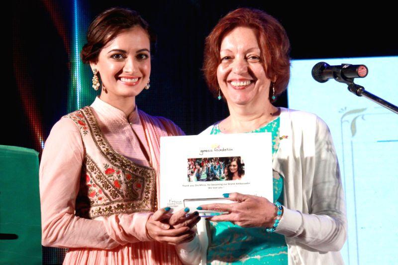 Actress Dia Mirza and Principal and Founder of Genesis Burson-Marsteller Prema Sagar at a fundraising event of Genesis Foundation`s (GF) Kids, in New Delhi on Nov 21, 2015.
