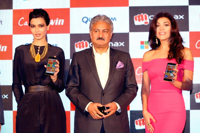 Actress Diana Penty with model Archana Vijaya during the launch of Micromax`s new Canvas in New Delhi on 16 June 2014. - Diana Penty